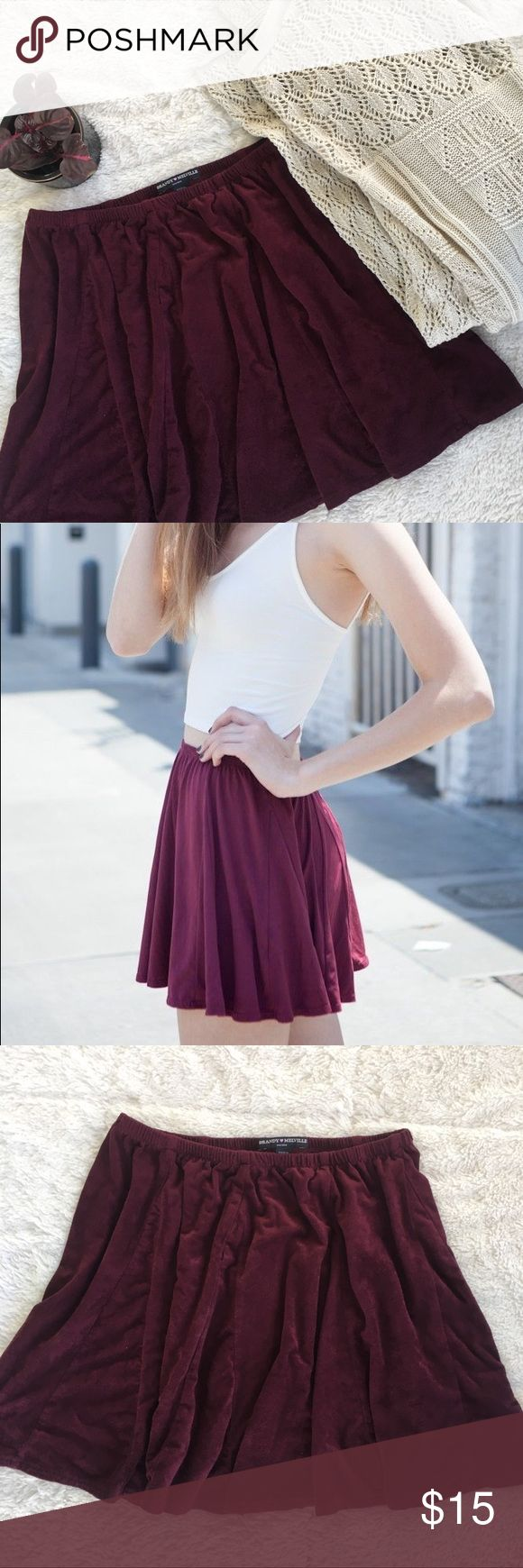 Brandy Melville Burgundy Suede Skater Skirt Worn once or twice, brandy melville dark burgundy skater skirt. Some photos from online picture it as a lighter color, but it is the dark burgundy mainly pictures. Very pretty color with no stains or rips. From a smoke free home. Brandy Melville Skirts Mini