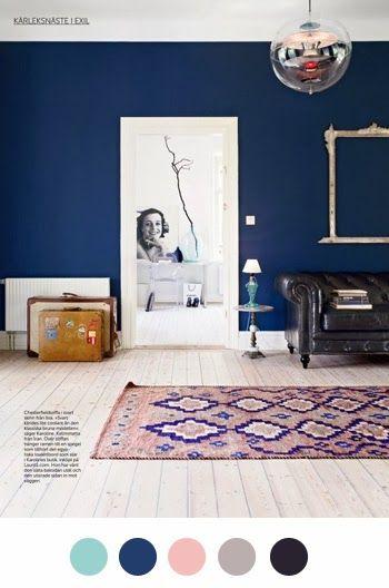 Navy walls, white wood floors, vintage, minimalist, peach compliments