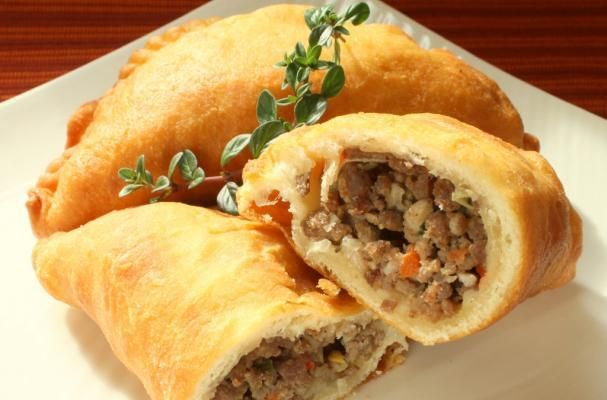 Handheld meat pies are a comforting Irish dish. If you are throwing a St. Patrick's day party, these meat pies are a must-have on the menu. Ground beef and pork are flavored with garlic, green onion, and red bell pepper. The filling