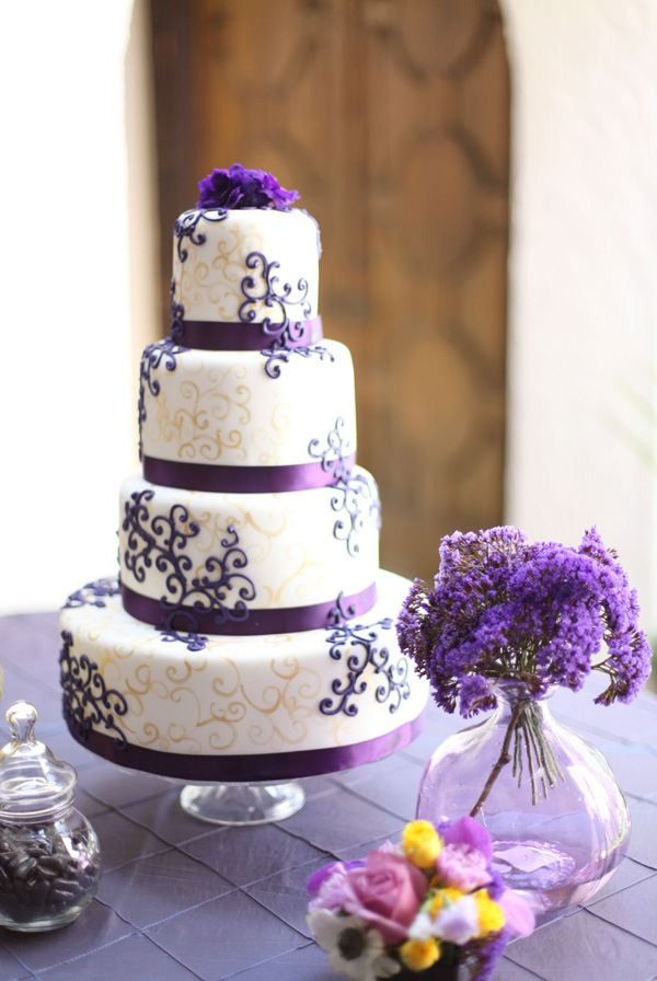 gorgeous cake! ...if only my current decision of wedding colors involved purple. the purple could be a different color though i suppose.