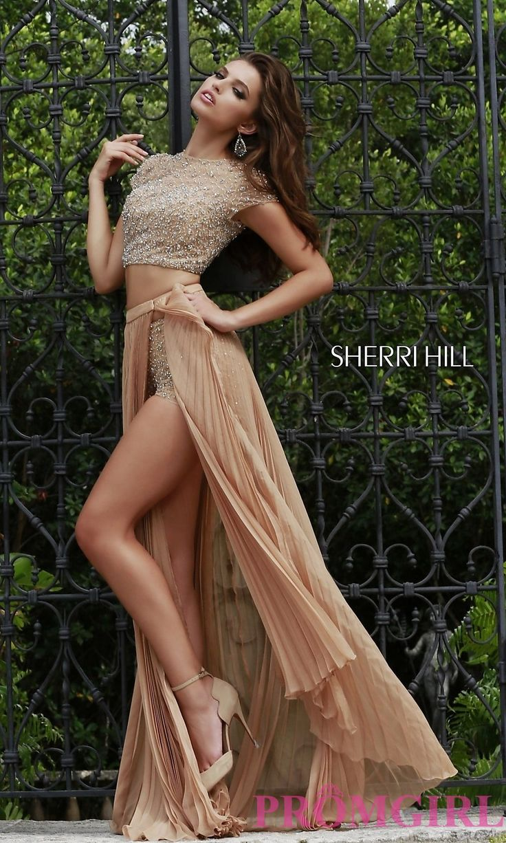 Two piece Sherri Hill nude prom dress with beaded top and shorts with pleated skirt.