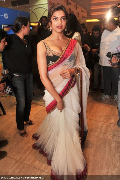 Embroidered black blouse with a white net saree. Shes such a great actress love u Deepika Padukone!!!!!!