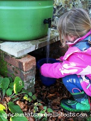 Great idea! A rain water collection tank for kids to use outside.