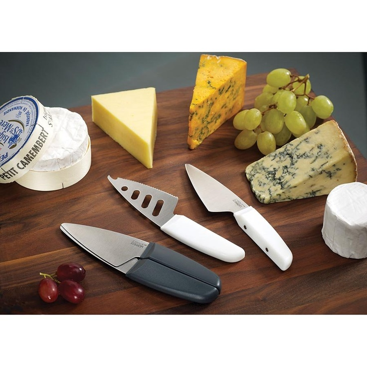 Duo Magnetic Cheese Knife Set. This wonderfully simple design comprises two individual cheese knives with magnetic handles that fit very neatly together for safe, compact storage. One knife has a conventional solid blade for slicing through hard cheese. The other knife has a pierced blade with a serrated edge,  perfect for cutting and serving all kinds of soft cheese. The magnetic handles clip together securely, protecting both the blades and your fingers when stored in a drawer.