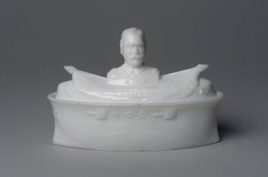 A covered milk glass dish - molded into a battleship, with a bust of Admiral George Dewey, (American Made, c.1899). Admiral Dewey was an American naval hero during the Spanish American War. ~ {cwl} ~ (Image/collection: Brooklyn Museum).