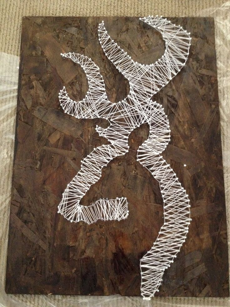 Browning deer logo! Homemade easy to do! All you need is wood, nails, string, and a stencil of any design you want! Love it!