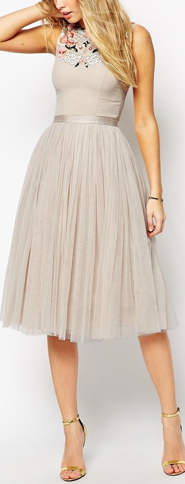 embellished folk midi dress I love the full skirt and smooth line over the hip.