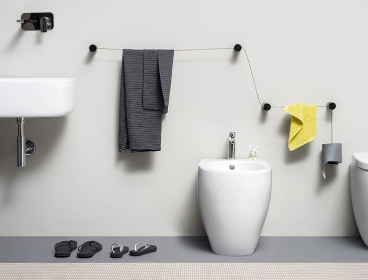 Dot, modular multi-functional towel holder