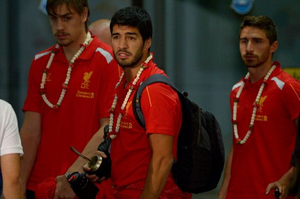 English Premier League football team Liverpool's, Luis Suarez (C), arrives at Don Muang International airport in Bangkok on July 25, 2013