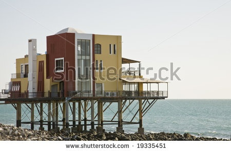 What if we raise them as is?  A building in Puerto Penasco (Rocky Point) Mexico built on stilts over the beach. by Chris Curtis, via ShutterStock