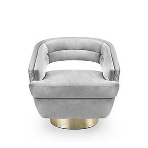 Russel is an accent chair both stylish for a living room or a lounge bar chair. Its crescent armrests lead to an open back, all layered over a comfy foam frame and upholstered in velvet. The base is round, produced in golden brass and can swivel 360 degrees.