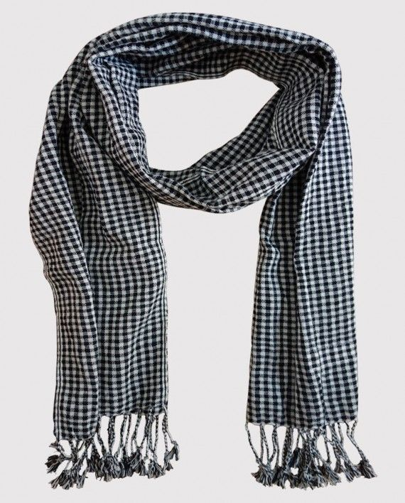 Black scarf from Cambodia, Krama Krama brand. Made in Cambodia handmade -- I really liked the look of the Cambodian krama scarves when we visited there. It's simple and iconic. I regret not getting one.