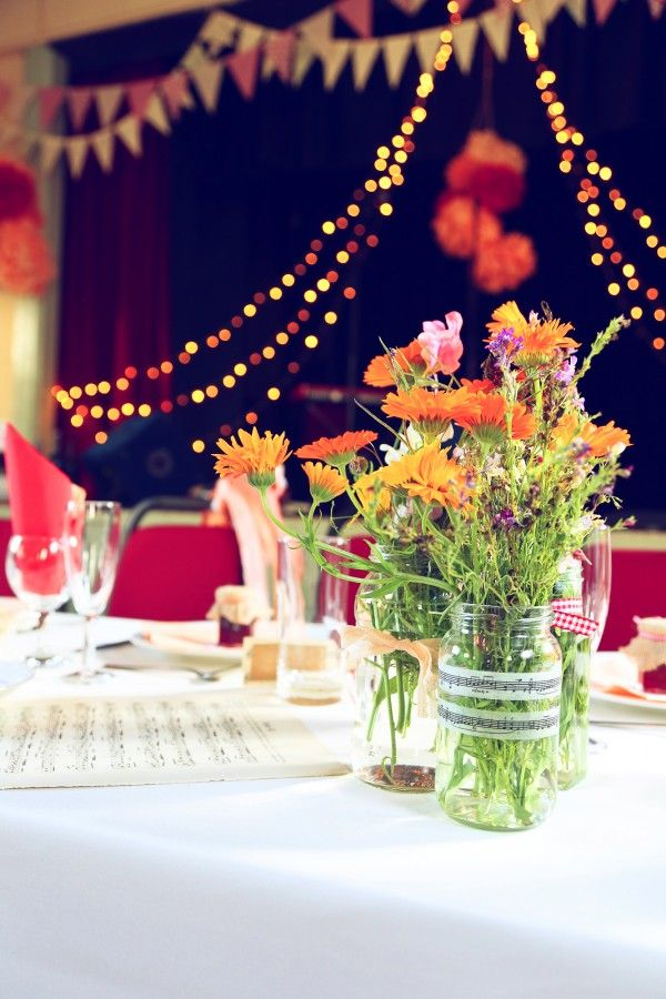 jam jar flowers DIY Colourful Village Hall Wedding http://myfabulouslife.co.uk/
