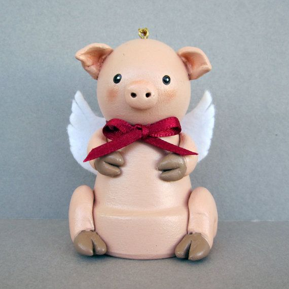 This little Flying Pig Bell is made from a small clay flower pot and has a bell inside. He is about 3 tall and has wings so he can fly. His arms,