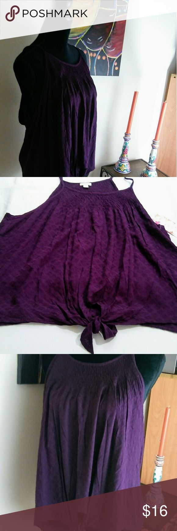 "Wild Pearl Tie Front Smocked Cami Purple Plum .Scoop neck - Sleeveless - Smocked neck trim - Front tie closure - Allover patterned detail - Approx. 24"" length (size S) - Imported fiber Content100% rayon Tops Camisoles"