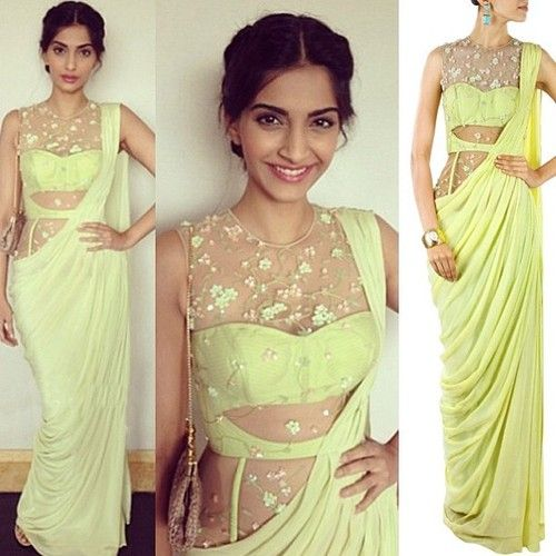 GET THIS LOOK: @sonamkapoor in the line green saree gown by Sonaakshi Raaj