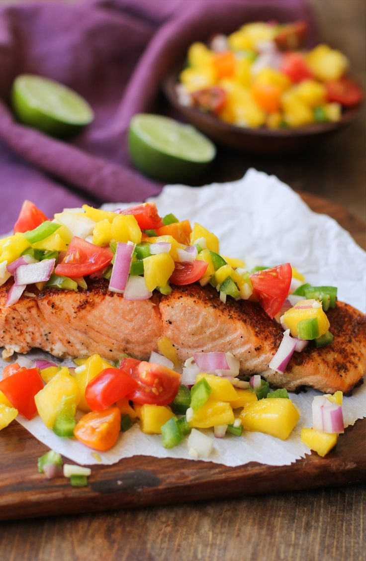 Toped with mango salsa, this grilled trout recipe is to delicious to miss out on!