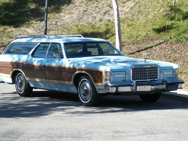 We had this Ford Country Squire station wagon in white. It was my job to detail this beauty...