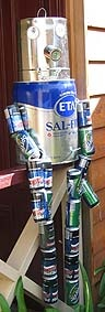 In this scarecrow idea, aluminium cans of various sizes have been strung together instead of flower pots.