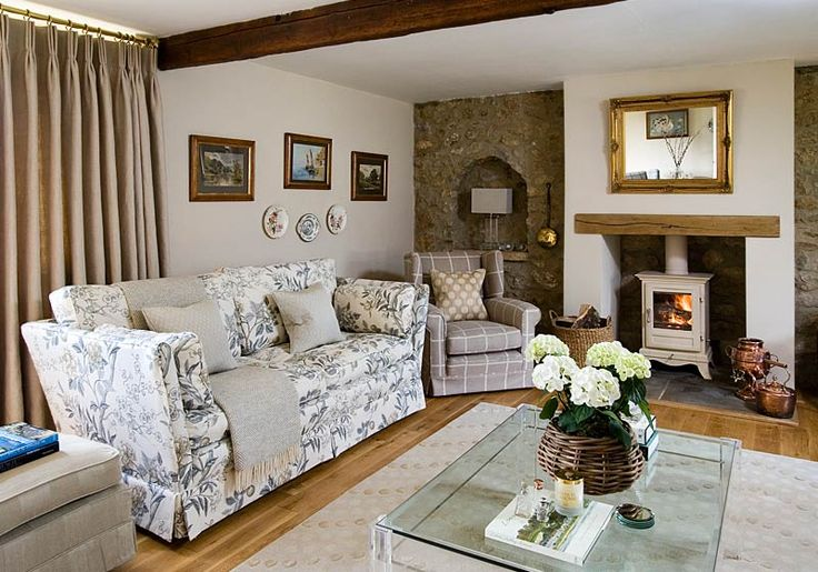 Wood burning stove, love the oak mantel and that the stove is painted white