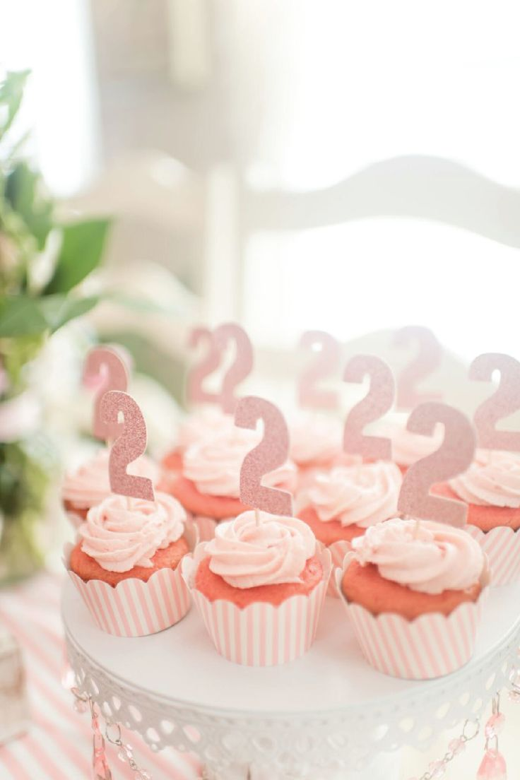 Celebrate your little girl's second birthday by throwing her a party fit for a princess. This peppy pink party theme is adorned with sparkly accents and the ultimate pink mascot—flamingos! See how this toddler birthday party came together with DIY decoration, dessert ideas (like these scrumptious rosy-hued cupcakes) and so much more!