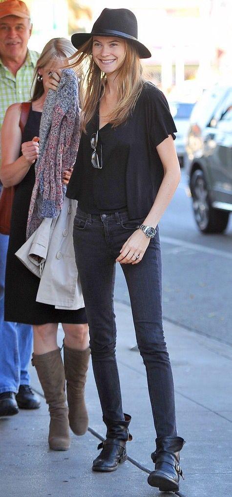 fluttery top + black jeans + black boots + fedora