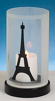Use this pretty Eiffel Tower glass centerpiece at your Parisian event. (potential dollar store hack idea!!)