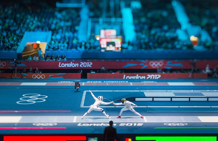 taly's Valentina Vezzali matches up against France's Ysaora Thibus in the semi-final match in the Team Foil eventPhotograph: David Levene for The Guardian