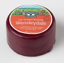Oak Smoked Yorkshire Wensleydale Cheese. Naturally smoked for 18 hours using oak chips, producing a cheese with a subtle, smoked flavour. The cheese maintains the crumbly characteristics of Real Yorkshire Wensleydale, whilst the rind adopts an attractive golden beech colour, being slightly firmer  stronger in flavour, imparted from the natural smoking process.