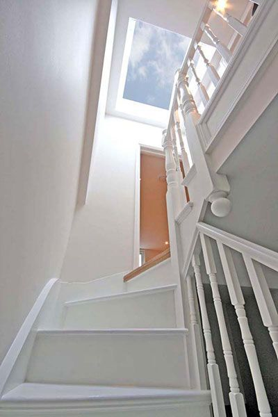 Let the light flood in with a roof window above a stairwell. Such a great way to light a dull area in your home.