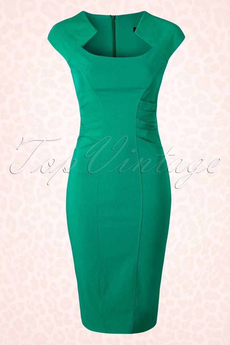 This 50s Leona Pencil Dress in Green by Vintage Chic gives you an instant vavavoom look! Super stylish dress with ruffles at the waist for a sexy silhouette! This fitted style features flattering short sleeves and an elegant queen-Anne top with diamond shaped neckline. The supple and stretchy emerald green viscose blend hugs your curves in all the right ways without marking any problem areas. Finished off with a hidden zipper and sexy slit at the back and h...