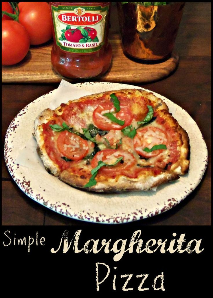 Simple Margherita Pizza is a quick & easy meal for school nights packed full of flavor! Make personal pan size pizzas for the whole house!
