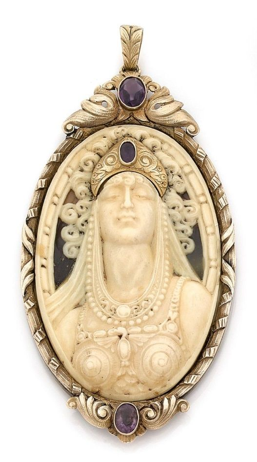 An antique gold, ivory, amethyst and imitation tortoiseshell pendant, circa 1900. Featuring an ivory cameo depicting a female bust, wearing a gold crown set with an amethyst, within an ornately carved gold frame set with amethysts, with an imitation tortoiseshell back. 10cm long. #antique #pendant