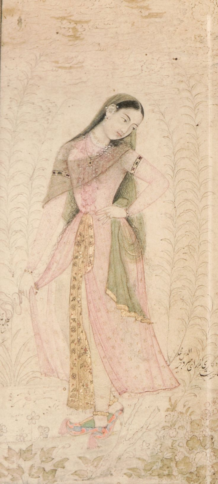 """ A slip of a young woman dressed in a pink -tinted *peshwaj*, a filmy overgarment speckled with blossoms and worn in conjunction with her blush-yellow *paijama*, a long golden *patka* ornamented with..."