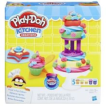 It's a Play-Doh frosting frenzy! Aspiring cake chefs can feel like pros with all the right tools to make lots of fun pretend cakes. Create Play-Doh Bundt cakes and crazy cakes that look like teddy bears and stars with the 3 cake molds, or build a crazy tiered cake with the 3 cake cutters and cake tier. Now for the best part  decorating! Cover the creations in fluffy Play-Doh Plus frosting with the frosting tool, which comes with 3 tips for a variety of shapes. Top it all off with make-bel...