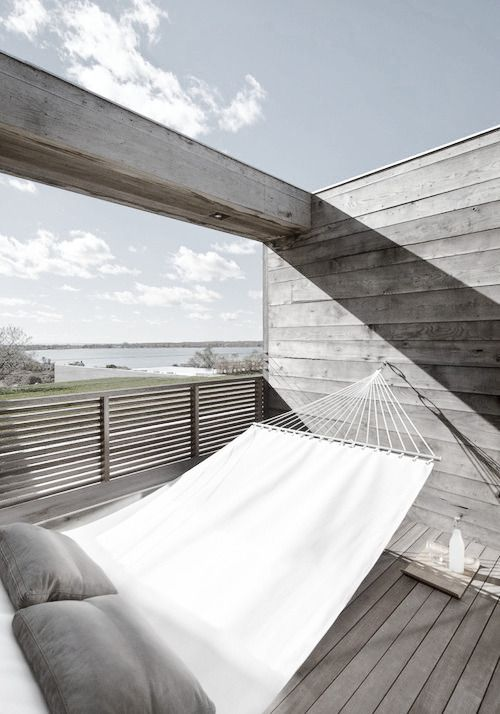 Swing on the wooden terrace. Minimalist style. Who would have asked for more?