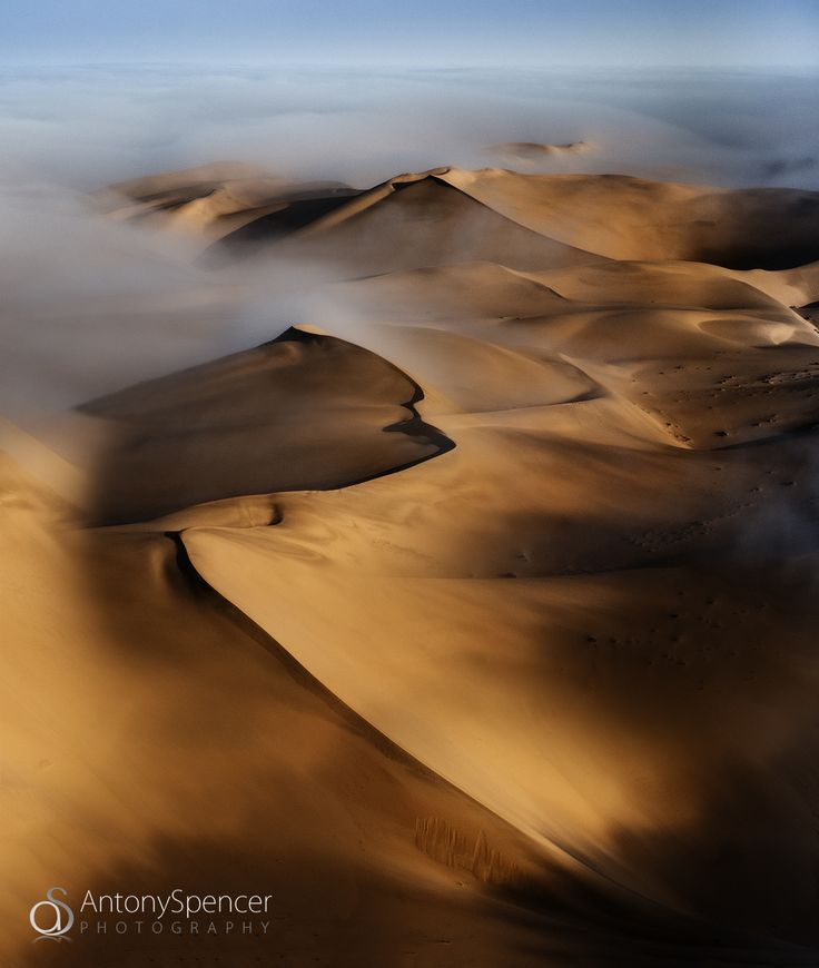 The Namib - Looking down on the dunes on a misty morning in the Namib Desert, Namibia.