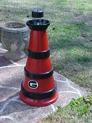 Handcrafted Georgia Bulldogs Solar lighthouse. Looks Great at night when lite comes on.