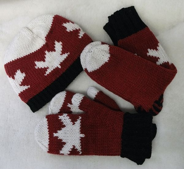 Maple leaf designs in red & black on hats, toques and mittens