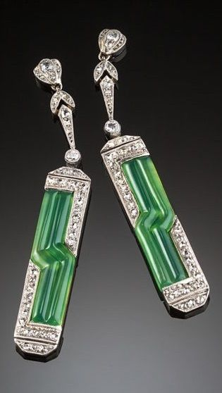 A pair of Art deco platinum, diamond and chrysoprase pendant earrings, European, 1920s. 4.6 x 7cm. The articulated delicate diamond surmounts suspending articulated pendants of angular lines of domed gem quality chrysoprase outlined with old cut diamonds.