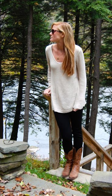 Cowboy boots, dark jeans, and large cream sweater. LOVE