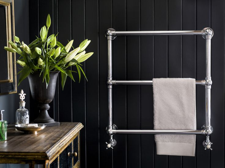Wall-mounted towel rails by Catchpole and Rye add an extra layer of warmth and style to any bathroom design: