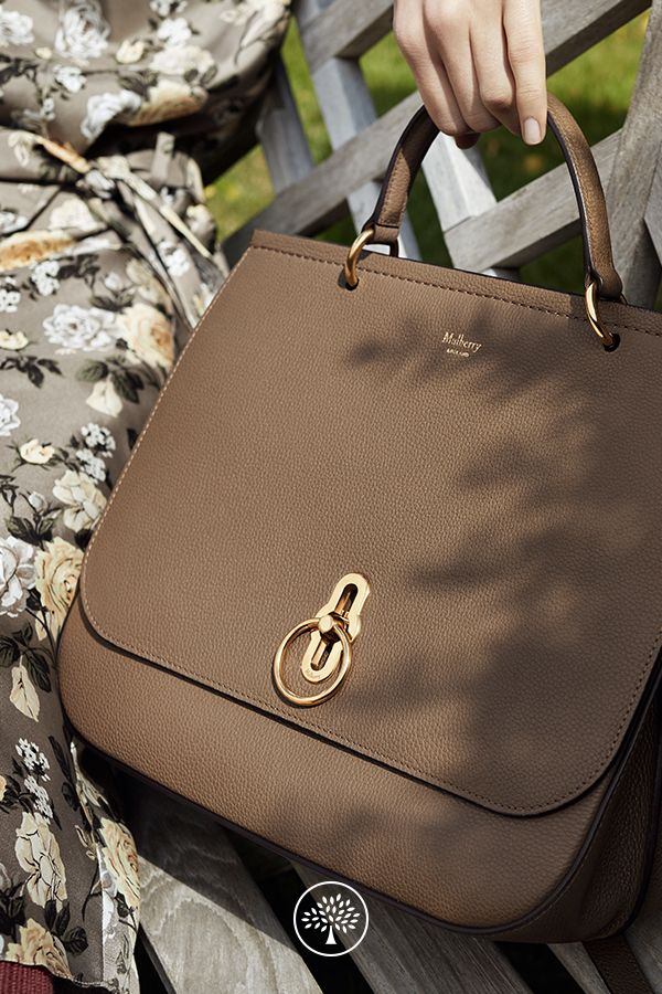 Shop the Amberley in Clay Leather at Mulberry.com. First seen on the London Fashion Week catwalk. Inspired by British countryside pursuits, the Amberley gets its ring hardware and satchel shape from traditional equestrian styling. Its unique rider's lock is a nod to a Mulberry icon - the design inspired by the centre of the postman's lock. The Amberley was named after a street in London's Maida Vale and is a multi-functional bag that can be carried in several ways.