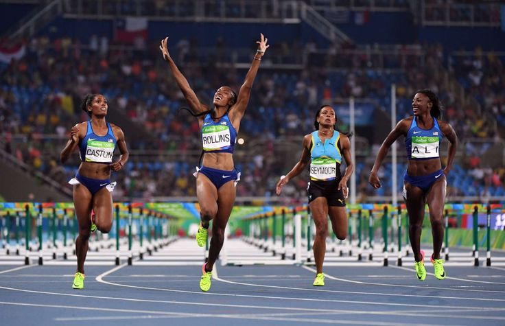 Brianna Rollins (USA) , Nia Ali (USA) and Kristi Castlin (USA) react after placing first, second and third, respectively during the women's 100-meter hurdles.