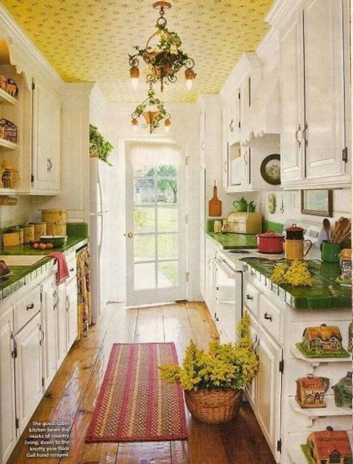 Wood floors, wall papered ceiling, green counters!