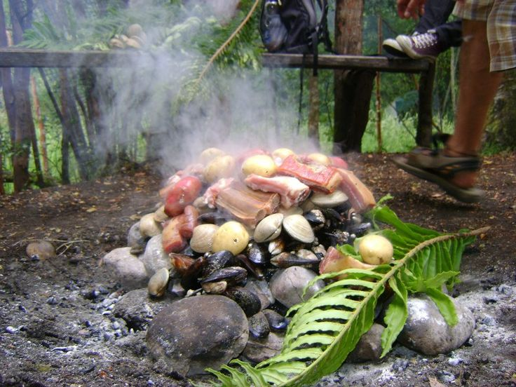 Curanto. Meats, seafood and potatos -and potato pastries- are cooked in a hole warmed with hot stones, and covered with leaves from the nalca plant. A delicious treat and a very interesting experience in Chiloe and Southern Chile.