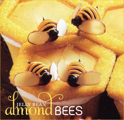 """Jelly Bean Almond Honey Bees decorate this cupcake from 'What's New, CupCake?"""" Love the hive too."""
