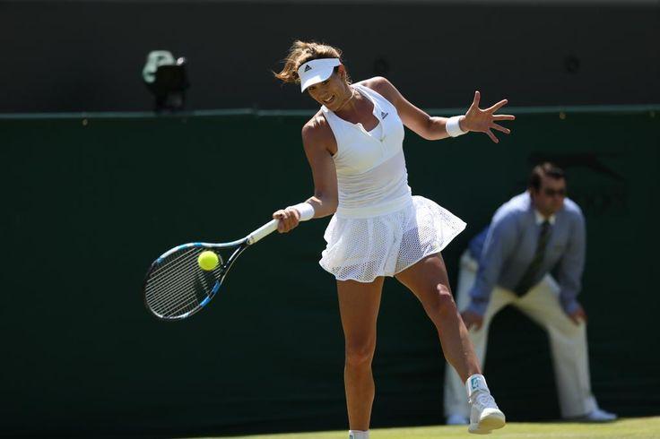Garbi Muguruza drops to her knees after a 7-6, 1-6, 6-2 win over former Wimbledon semi-finalist Angelique Kerber. Wimbledon 2015