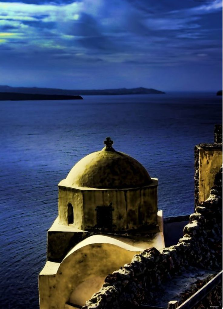 Full moon over the castle and the church in Oia village, Santorini island, Greece - Selected by www.oiamansion.com