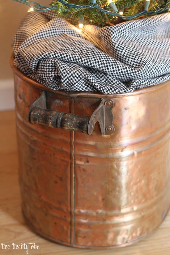 Use an antique copper boiler as a tree stand
